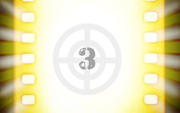 Cinema film strips with countdown and projector light rays. A cinema film strip with countdown and projector light rays Royalty Free Stock Photography