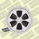 Cinema film tape on disc Royalty Free Stock Photography
