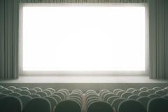 Cinema grigio con lo schermo in bianco Immagini Stock