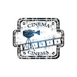 Cinema grunge rubber stamp. Blue grunge rubber stamp with numbered filmstrip, movie camera shape and the word cinema written inside the stamp Royalty Free Stock Photos