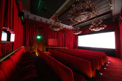 Cinema hall with chandeliers and seats. Royalty Free Stock Photos
