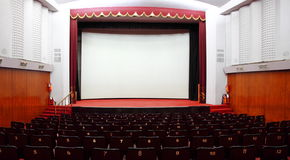 Cinema Hall. Full view of Cinema Hall - with white silver screen and chairs Royalty Free Stock Images