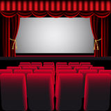 Cinema hall with red curtain Stock Photos