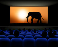 Cinema hall with rows of seats and screen with movie Royalty Free Stock Photos