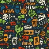 Cinema hand drawn seamless pattern with lettering on dark. Movie making film symbols collection. Cinematography design. Items: camera, film tape, popcorn, chair Stock Photos