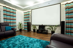 Cinema at home. Big new cinema in luxury lounge at home royalty free stock photography