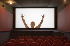 Cinema with human silhouette Royalty Free Stock Images