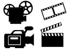 Cinema industry. Clapboard and film and video camera on the white background Royalty Free Stock Photography