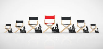Cinema Industry Concept. Director Chairs, Movie Clappers and Meg. Aphones in Row with Red One in Centre on a white background. 3d Rendering Stock Photo