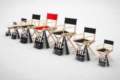 Cinema Industry Concept. Director Chairs, Movie Clappers and Meg. Aphones in Row with Red One in Centre on a white background. 3d Rendering Stock Images