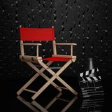 Cinema Industry Concept. Red Director Chair, Movie Clapper and M. Egaphone on a black background. 3d Rendering Royalty Free Stock Photography