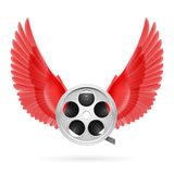 Cinema inspired. Realistic film reel with red wings emblem Stock Images