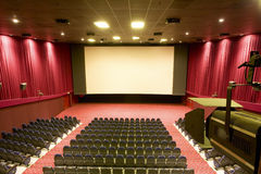 Cinema interior. With red walls Royalty Free Stock Photography
