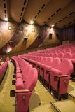 Cinema interior. Pink row #7 of empty cinema auditorium with line of chairs Royalty Free Stock Images