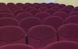 Cinema interior with comfortable red chairs. Stock Image