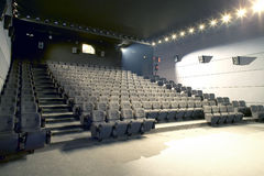 Cinema interior with lights on and projector cabin Royalty Free Stock Photography