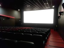 Cinema interior of movie theatre with empty red and black seats Stock Photography