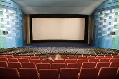 Cinema interior with people royalty free stock photography