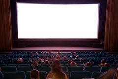 Cinema interior with people. Cinema auditorium with line of chairs, sitting visitors watching the movie and silver screen. Ready for adding your own picture Royalty Free Stock Images
