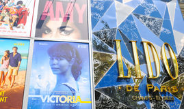 Cinema Lido in Paris. Paris, France - July 9, 2015: Detail of billboard displaying movies shown at the Lido cinema on Champs Elysees, Paris, France Royalty Free Stock Photos