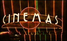 Cinema marquee. Illuminated neon sign for movie theater Royalty Free Stock Images