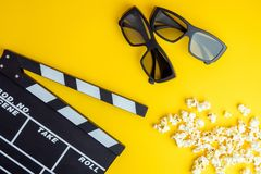 Cinema minimal concept. Watching film in the cinema. 3d glasses, popcorn, clapper board Royalty Free Stock Image