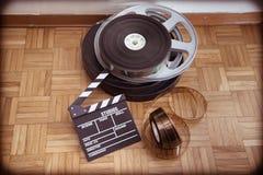 Cinema movie clapper board and film reel Stock Photo