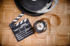 Cinema movie clapper board and film reel Royalty Free Stock Photos