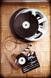 Cinema movie clapper board and film reel Stock Images
