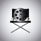 Cinema and movie design. Cinema reel film tape  and director chair icon over white background. colorful design. vector illustration Stock Photography