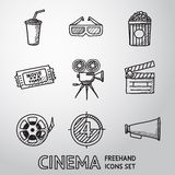 Cinema, movie freehand icons set. Vector. Cinema, movie freehand icons set with - cinema projector, film strip, 3D glasses, clapboard, popcorn in a striped tub Royalty Free Stock Photography