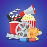 Cinema movie poster design template.. Movie film reel and strip, ticket, popcorn, clapper board, soda takeaway, 3d glasses, megaphone on blue background. Vector Royalty Free Stock Photo