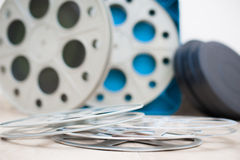 Cinema movie reel with boxes in background Royalty Free Stock Photos
