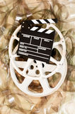 Cinema movie reel and clapper board 35 mm film background Royalty Free Stock Photo