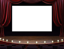 Cinema movie theater. With curtains, screen, seats and lighted stage. Room for text or copy space advertisement Royalty Free Stock Photo