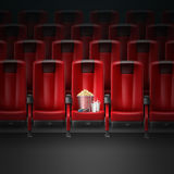 Cinema movie theater. Vector red modern comfortable seats in cinema movie theater with pocorn, 3d glasses and two beverages Stock Photography