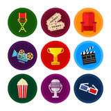 Cinema and movies icon set. Vector flat movie elements with armchair, award, camera, popcorn and a microphone. Concept cinema Stock Photos