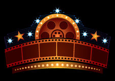 Cinema neon. Gold film strip at neon sign with reel and stars Royalty Free Stock Images