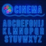 Neon latin alphabet. Cinema neon signboard and blue neon glowing latin alphabet against a brick wall background. Vector illustration Royalty Free Stock Photography
