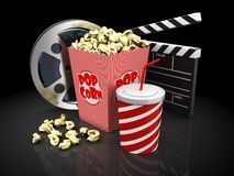Cinema objects over black background. Popcorn, cup of soda, film slate and movie reel Royalty Free Stock Photography