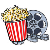 Cinema objects - popcorn bucket and retro style film reel Royalty Free Stock Photo