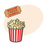 Cinema objects - popcorn bucket and retro style ticket. Sketch vector illustration with place for text. Typical movie attributes like popcorn in red and white Royalty Free Stock Photo