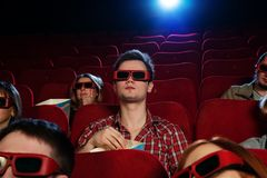 In a cinema. People in 3D glasses watching movie in cinema royalty free stock images