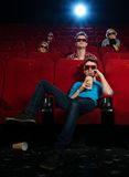 In a cinema. People in 3D glasses watching movie in cinema stock photography