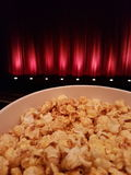 Cinema and Popcorn. Red Curtains with Popcorn royalty free stock image