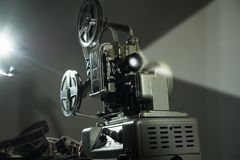 Cinema projector with a film on dark background stock photos