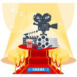 Cinema on red carpet. Megaphone, camera and clapboard on luxurious catwalk with red carpet. Flat vector cartoon illustration. Objects isolated on a white Royalty Free Stock Images