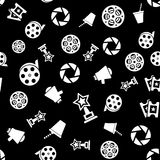 Cinema retro movies icons seamless pattern. Tiling ornament on black. Vector illustration Stock Images