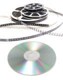 Cinema roll film and cd. On a white background royalty free stock photo