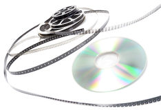 Cinema roll film and cd. On a white background royalty free stock photos